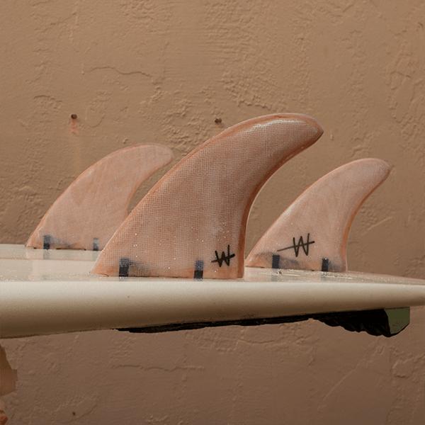 FCS Thruster Set on Surfboard